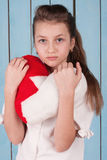 Portrait of girl who holding the heart shaped plush pillow Royalty Free Stock Photos