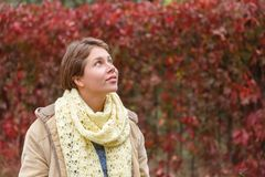 Portrait of a girl who is looking up in a white scarf. Stock Images