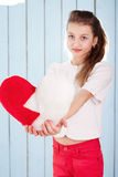Portrait of girl who showing the heart shaped plush pillow Royalty Free Stock Images