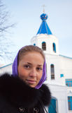 Portrait of a girl winter. Girl standing at the church winter day Royalty Free Stock Image