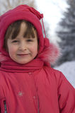 Portrait of a girl in winter clothing. Portrait of a little girl outdoors Stock Images