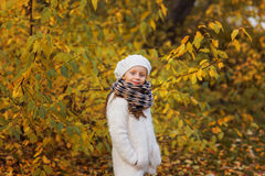 Portrait of a girl in winter day hat with curly hair Royalty Free Stock Image