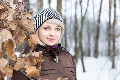 Portrait of a girl in the winter forest. Stock Image