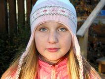Portrait of a girl in a winter hat stock photos