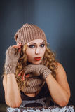 Portrait of a girl in a winter hat and mitten Royalty Free Stock Image