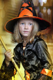 Portrait of girl in witch costume. Charming little witch with hat Royalty Free Stock Images