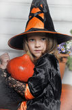 Portrait of girl in witch costume Stock Photos