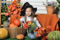Portrait of girl in witch costume Stock Images