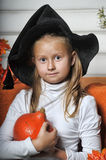 Portrait of girl in witch costume Stock Photo
