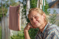 Portrait of the girl. The woman dries bedding in the street Stock Images