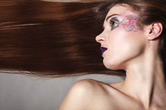 Portrait of girl woman with long straight hair and creative makeup Stock Photos