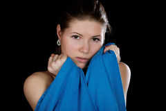 Portrait of the girl  wrapped up dark blue fabric on a black Stock Photo
