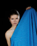 Portrait of the girl  wrapped up dark blue fabric Stock Image