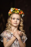 Portrait of a girl with a wreath. Of flowers studiorn royalty free stock photo