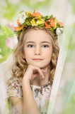 Portrait of a girl with a wreath. Of flowers studio r n stock photography
