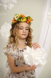 Portrait of a girl with a wreath. Of flowers studio royalty free stock images