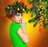 Portrait of a girl in a wreath of fir branches on abstract backg Stock Photography