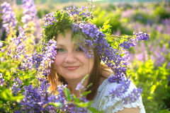 Portrait of a girl in a wreath of wild flowers. Portrait of a girl of Slavic appearance in a wreath of wild flowers Royalty Free Stock Images