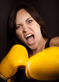 Portrait of a girl in yellow boxing gloves Royalty Free Stock Photo