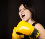 Portrait of a girl in yellow boxing gloves Stock Photos