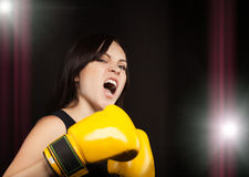 Portrait of a girl in yellow boxing gloves Stock Image