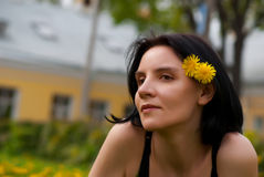 Portrait of a girl with a yellow dandelion Royalty Free Stock Photo