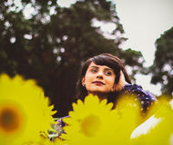 Portrait of Girl With Yellow Flowers Royalty Free Stock Photos