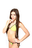Portrait of girl in a yellow swimsuit on white background Royalty Free Stock Image