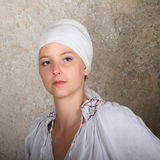 Portrait of a girl. Young woman - girl in white embroidered blouse and headscarf Stock Photo