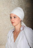 Portrait of a girl. Young woman - girl in white embroidered blouse and headscarf Royalty Free Stock Image