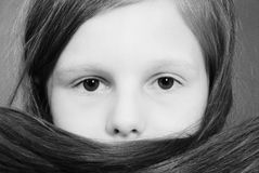 Portrait girls covers her face with hair Royalty Free Stock Images