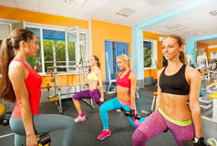 Portrait of girls doing exercises in gym Royalty Free Stock Photos