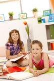 Portrait of girls doing homework Stock Image