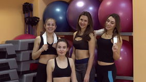 Portrait of girls in the gym looking in camera and smiling, slow motion. stock video