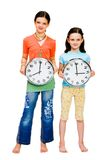 Portrait of girls holding clocks Stock Photo