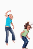 Portrait of girls jumping Royalty Free Stock Images