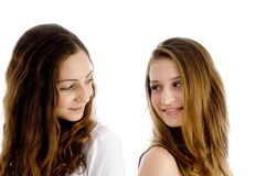 Portrait of girls looking to each other Royalty Free Stock Images