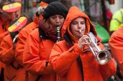 portrait of girls playing trumpet in fanfare band in the street stock image