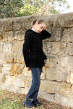 Portrait girls of the teenager near a wall. Stock Photo