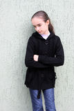 Portrait girls of the teenager near a wall. Stock Images