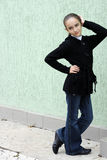 Portrait girls of the teenager near a wall. Royalty Free Stock Photo