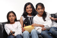 Portrait of Girls watching TV Stock Image