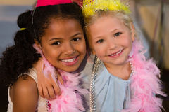 Portrait of girls wearing feather boa Royalty Free Stock Photography