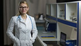 Portrait of glad female doctor smiling at hospital stock footage