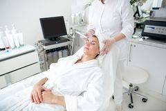Positive lady having procedure with special tool royalty free stock image