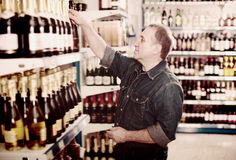Portrait of glad man buying a wine Royalty Free Stock Images