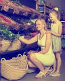 Portrait of glad woman and girl buying greens Royalty Free Stock Photography