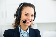 Portrait of glad woman working in call center Stock Photography