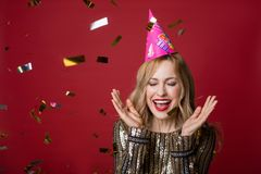 Pleased lady taking pleasure in celebration royalty free stock images