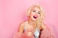 Portrait of glam girl on  background. Portrait of glam girl on pink background Royalty Free Stock Photography